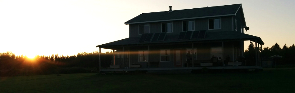 Picture of Inn at sunset with guests